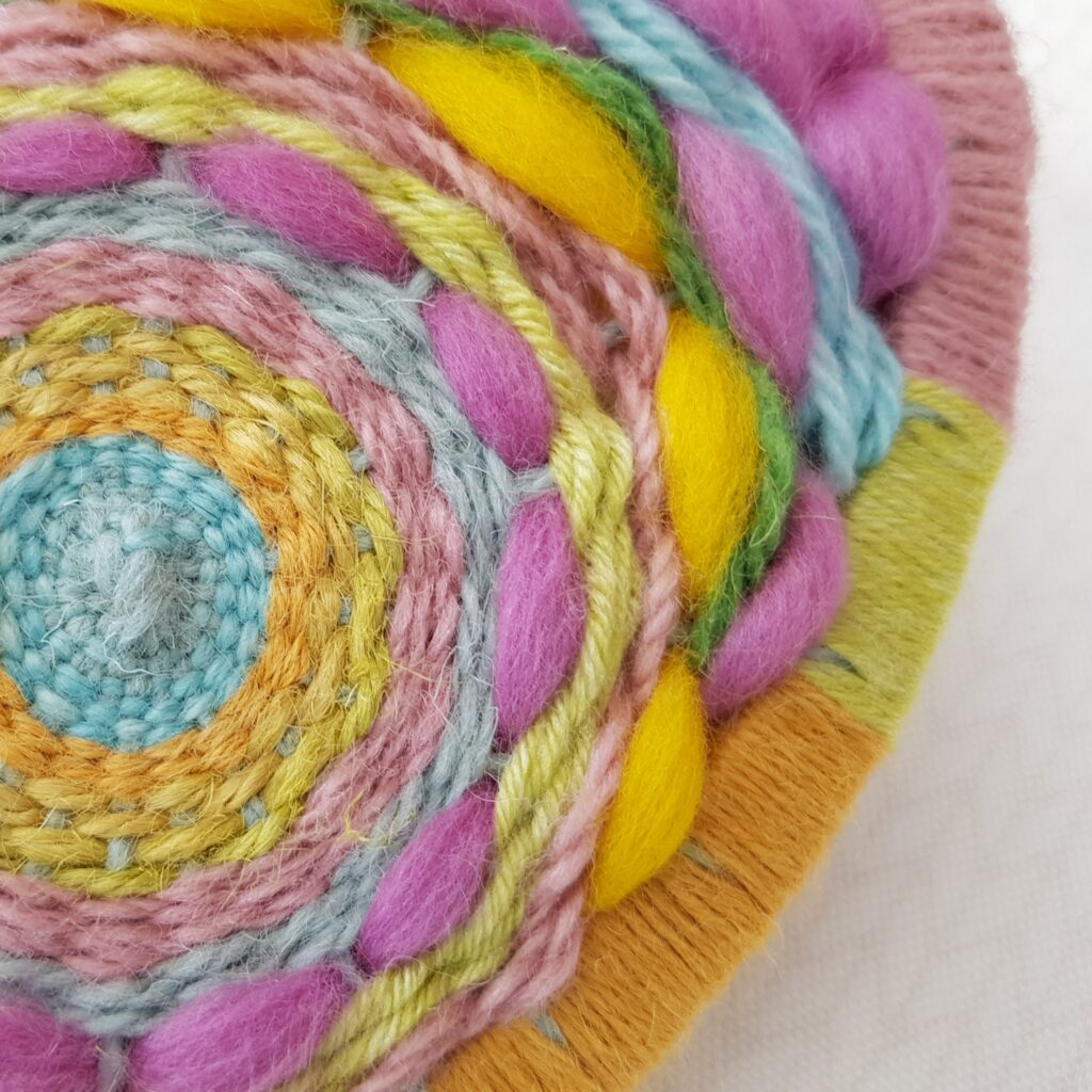 Oval Woven Wall Hanging in Spring Colours including pale blue, orange, yellow, lime green and pink